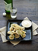 Pelmeni with smetana (filled pasta parcels with sour cream)