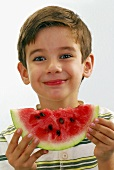 Small boy with a slice of watermelon