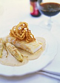 Cod with fried onions, beer sauce and chicory