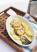Baked cod with lemon slices and horseradish
