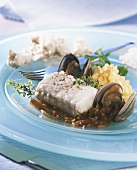 Steamed coley fillet with clams and potatoes