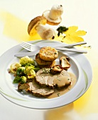Roast wild boar with ceps and Brussels sprouts