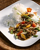 Strips of wild boar with vegetables and rice noodles