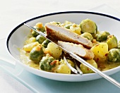 Brussels sprout curry with chicken escalope