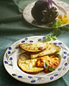 Fried aubergine slices with spicy tomato sauce