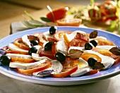 Caprese con le olive (Tomatoes and mozzarella with olives)
