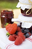 Berry jam as a gift and fresh berries