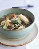 Noodle soup with meat, shrimps and squid (Vietnam)