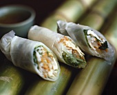 Unbaked spring rolls filled with shrimps, meat & mushrooms