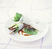Rice paper cones filled with beef and leafy vegetables