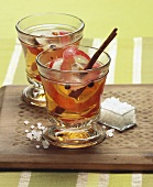 Apple punch with cinnamon stick and pearl sugar