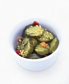 Slices of gherkin in a small bowl