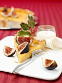 A piece of lemon tart with figs