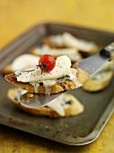 Cheese, pear and tomato crostini
