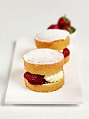 Small sponge cakes with strawberry and cream filling