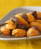 Duck and apricot kebabs