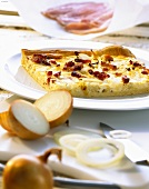 A piece of onion quiche with bacon