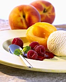 Peach Melba with raspberry sauce