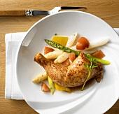 Roast chicken leg on vegetables