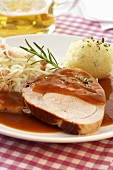 Roast pork with potato dumpling and Bavarian sauerkraut