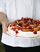 Pavlova with peaches and raspberries