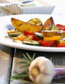 Oven-baked vegetables with avocado sauce