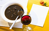 Oxtail soup and a glass of red wine