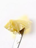 Knob of butter on knife