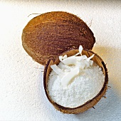 Grated coconut in coconut half and whole coconut
