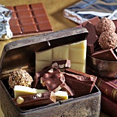 Pieces of chocolate and chocolates in a metal box