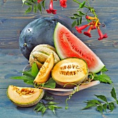 Various types of melons, whole and pieces