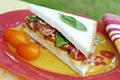Coppa, tomato and cheese sandwich