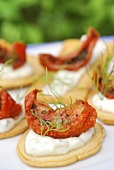 Appetisers with tzatziki and pickled tomatoes