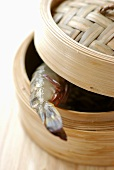 Bamboo steaming basket with shrimp