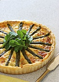 Salmon and asparagus quiche with rocket