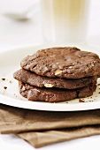 Three chocolate cookies on a plate