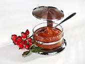 Rose hip jam in a small bowl