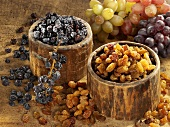 Raisins and currants in wooden bowls