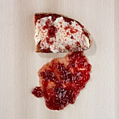 Jam and bread, dropped on the floor