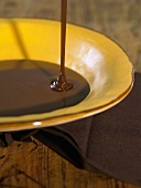 Melted chocolate running into a dish