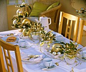 Table laid for coffee with arrangements of mistletoe