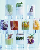 A selection of small appetisers in glasses