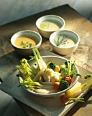 Steamed vegetables with three cheese sauces
