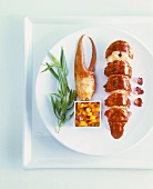 Lobster with mango salsa and sprig of tarragon