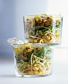Sprout salad in two glass bowls with herb quark