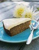 A piece of apple and carrot cake with vanilla quark