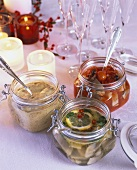Various types of pickled herrings in jars