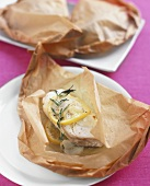 Fish fillet baked in baking parchment with rosemary & lemon