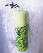 Pea milk shake surrounded by ice