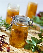 Apricot jam with raisins in a jar